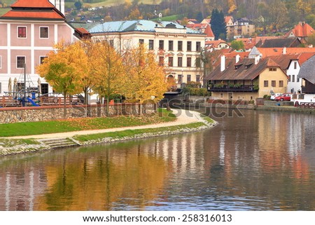 Old traditional buildings on both banks of Vltava river in autumn, Cesky Krumlov, Czech Republic - stock photo
