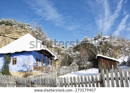Old traditional countryside house in winter - stock photo