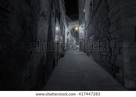 old traditional courtyard in small medieval town of Sorano in Italy - stock photo