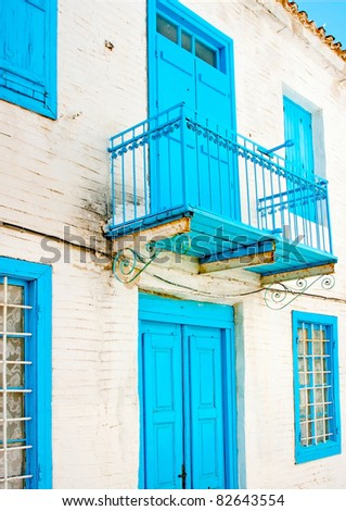 Old traditional  house with blue doors  and windows in Skiathos Greece - stock photo