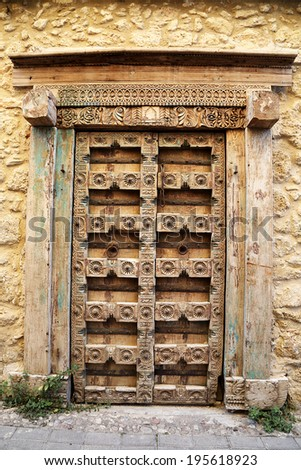 Old Traditional Weathered and Carved Door - stock photo