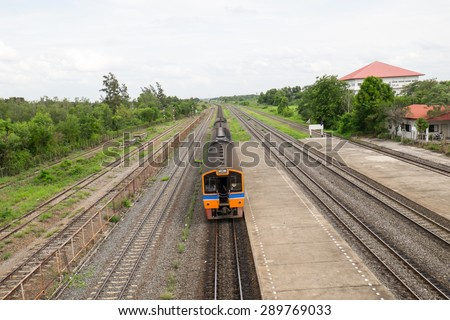 Old train engine and rail track in rural of Thailand - stock photo