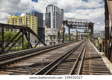 Old train track in the city - stock photo