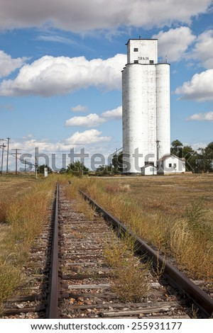 Old train tracks and grain silo in Colorado - stock photo