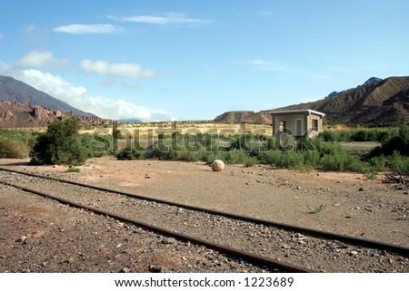 Old train tracks through the mountains - stock photo