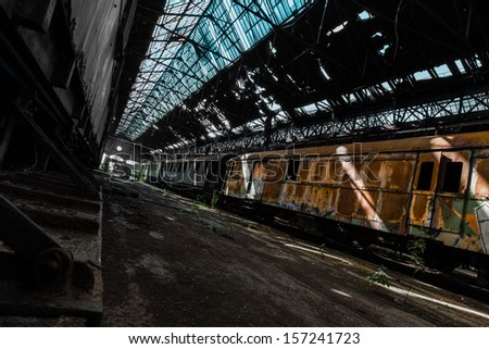 old train wreck in an abandoned warehouse - stock photo