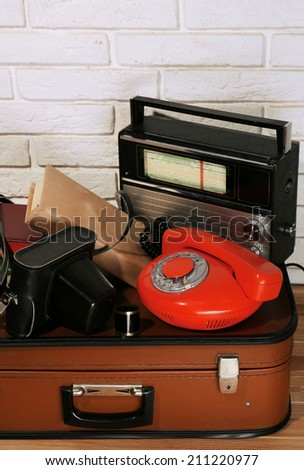 Old travel suitcases with retro things, close up - stock photo