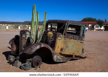 Old Truck with cactus - stock photo