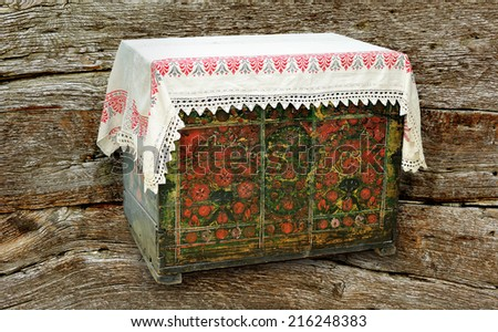 Old trunk on wood background. - stock photo
