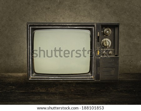 Old tv on wood in room. - stock photo