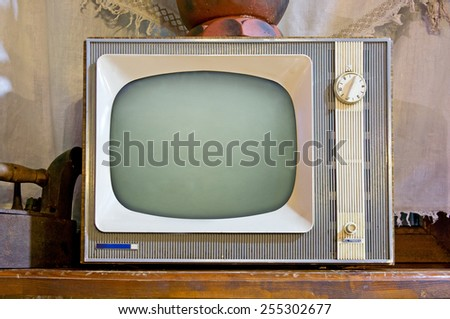Old tv set in vintage interior - stock photo