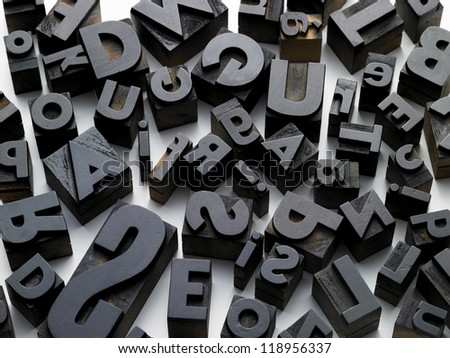 old typefaces scattered composition on a white background - stock photo