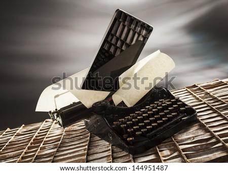 old typewrite and sheet on cardboard - stock photo