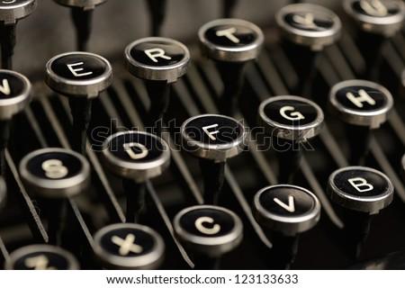 Old typewriter keys. Close-Up of keys on an antique typewriter. Shallow DOF. - stock photo
