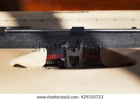 Old typewriter machine detail without paper, retro toned image. - stock photo