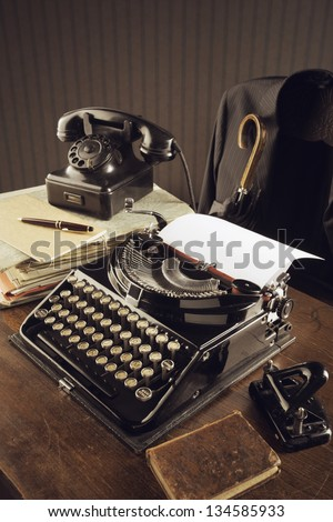 Old typewriter on a wooden desk - stock photo