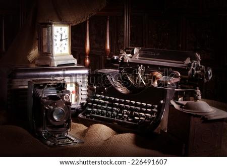 Old typewriter, retro camera and radio receiver                 - stock photo