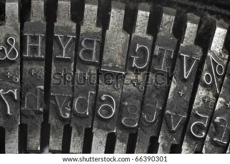 Old typewriter type - stock photo