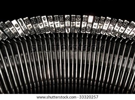 Old typewriter type bars - stock photo