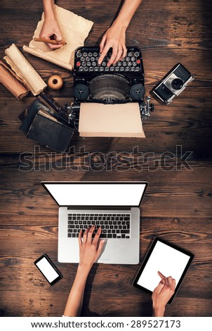 Old typewriter with laptop, concept of technology progress - stock photo