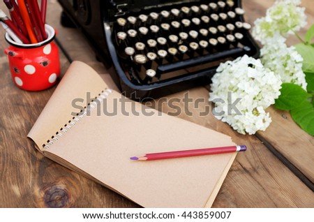 old typewriter with Russian letters on a wooden background - stock photo