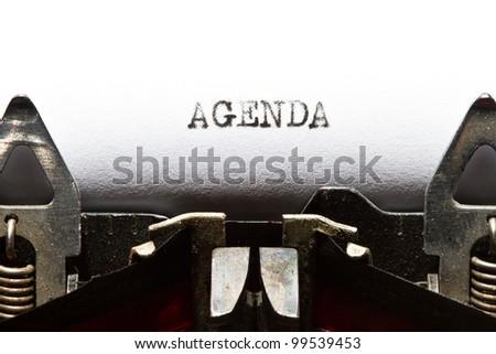old typewriter with text agenda - stock photo