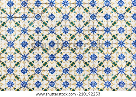 Old typical azulejos on the building's exterior in Lisbon, Portugal. - stock photo