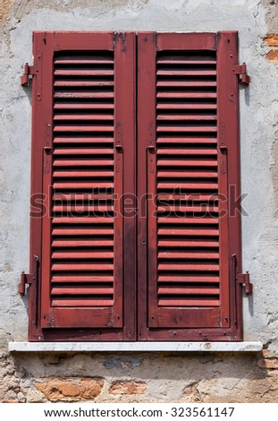 Old typical italian window - stock photo