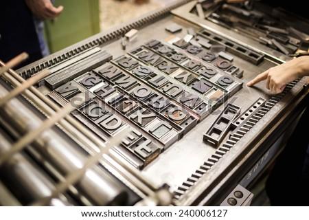 Old typography printing machine - stock photo