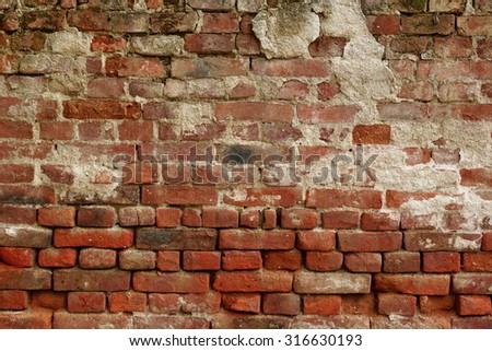 Old Uneven  Crumbling Red Brick Wall Background Texture - stock photo