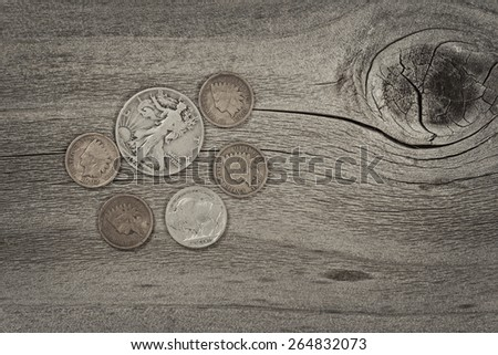 Old United States coins on rustic wood with vintage concept. Layout in horizontal format.  - stock photo