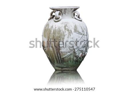 Old urn vase in the garden - stock photo