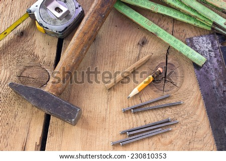 Old used carpentry tools on wooden background  - stock photo