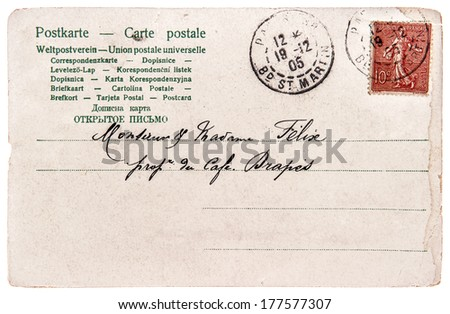 old used handwritten postcard letter with stamp and unreadable undefined address text - stock photo