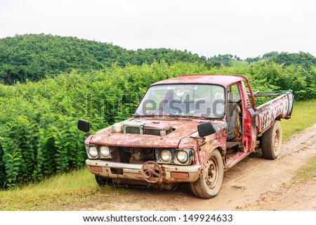 Old used pickup on road in rural of Thailand - stock photo