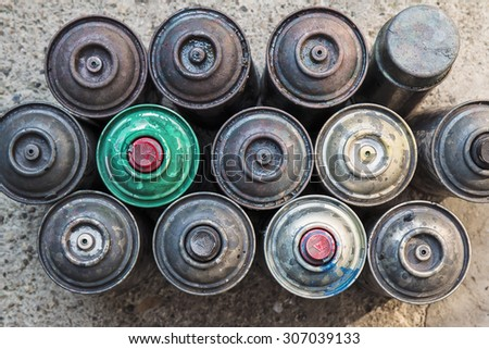 Old used rusty Aerosol Spray cans, ideal background - stock photo