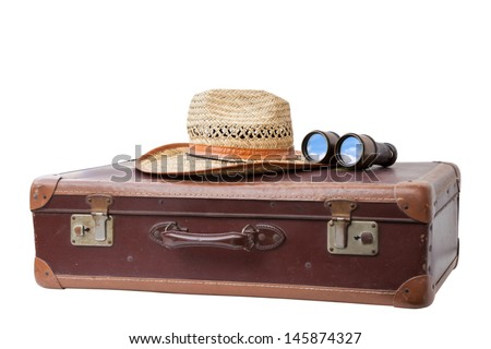 Old used suitcase with Hat and antique Binoculars  isolated on white background.  - stock photo