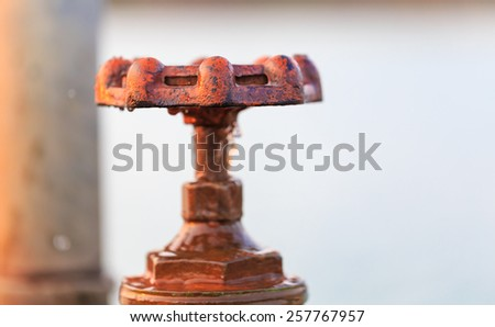 old valve of the water pipe leaked - stock photo