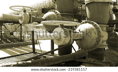 Old valve on the pipeline - stock photo