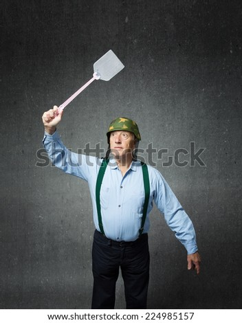 old veteran soldier armed with weapon for mosquito - stock photo