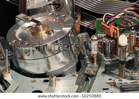 Old VHS VCR magnetic reading and recording head - stock photo