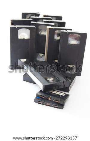 Old VHS Video and Audio Cassettes Isolated on a White Background. - stock photo