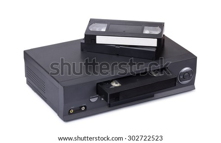 Old VHS video recorder with cassettes isolated on white background - stock photo