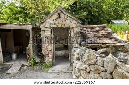 Old Victorian outhouse and coal shed, On farm in rural England, United Kingdom. - stock photo
