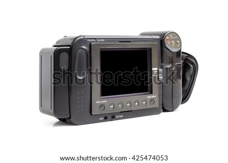 Old Video Camcorder on white background. - stock photo