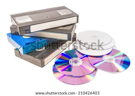 old video cassette and CD DVD on white background  - stock photo