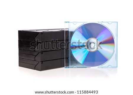Old Video Cassette tapes with a DVD disc isolated on white background - stock photo