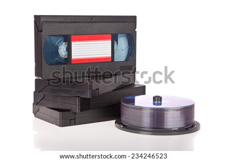 Old Video Cassette tapes with DVD discs isolated on white background - stock photo