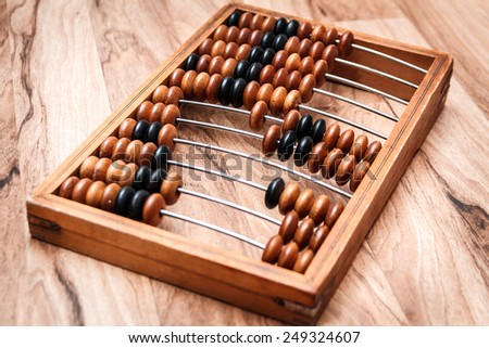Old vintage abacus on a wooden table - stock photo