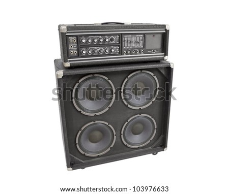 Old vintage bass amplifier isolated on white. - stock photo